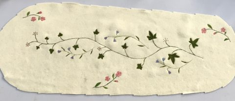 Ivy, harebell, dogrose coffin cover